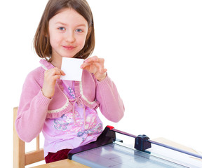 little girl is cutting paper