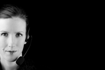 Monochromatic image of a woman in a headset