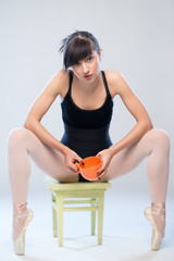 aggressive gymnast sitting on a chair with cup