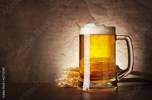 Mug of lager beer with spikelets