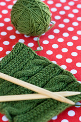 Knitted patterns and spokes on a polka dot background
