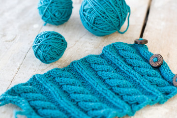 Knitting pattern on a wooden background