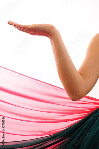 Beautiful bellydancer arm with colorfull fabric