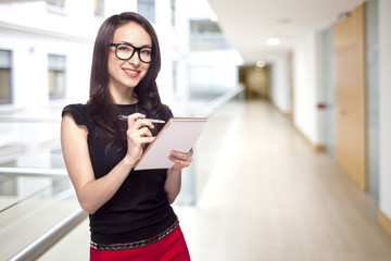 Girl in office with paper notepad