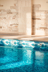 Indoor shot of swimming pool with clean blue water