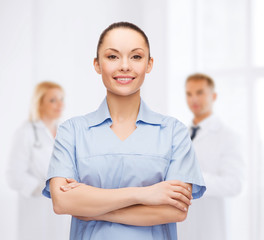 smiling female doctor or nurse