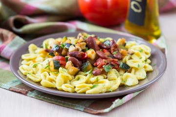 Italian pasta orecchiette with stew of vegetables and beans