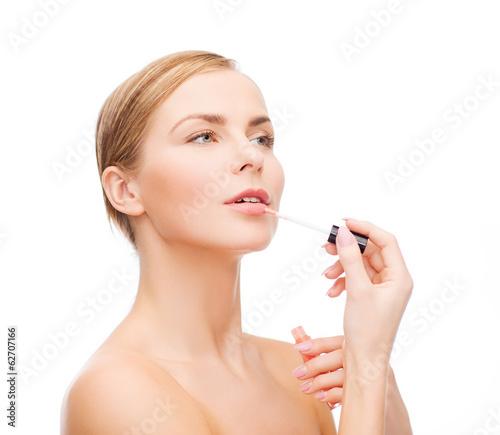beautiful woman with lipgloss