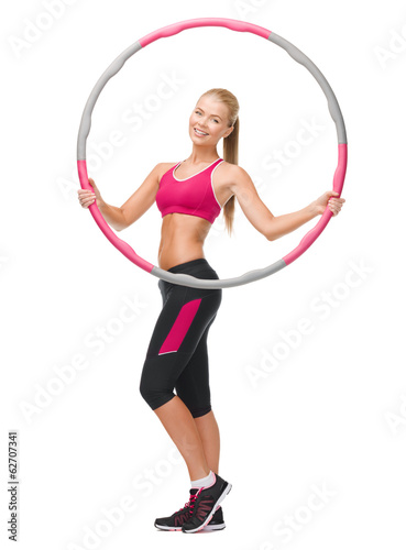 young sporty woman with hula hoop