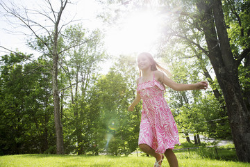 Young Girl In Pink Patterned Sundress Running