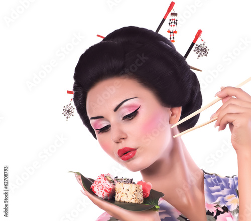 woman in Japanese kimono with chopsticks and sushi roll