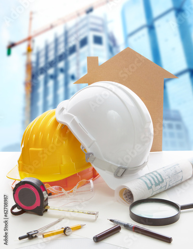 safety helmet blue print plan and construction equipment on arch