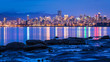 Vancouver city lights at twilight from Jericho Beach, British Columbia Canada.