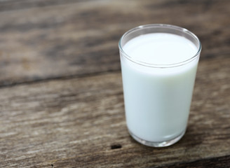 glass of milk on wooden table