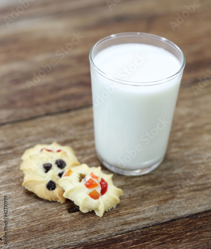 cookies and a glass of milk on wood table