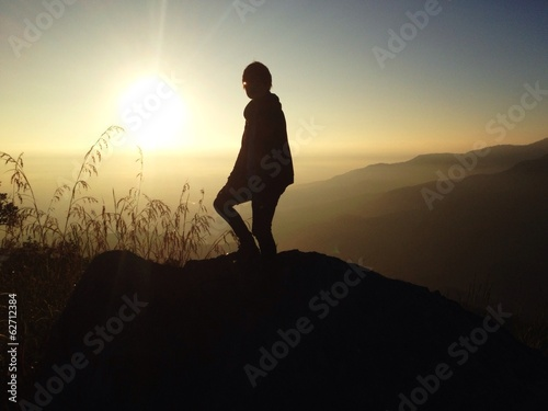 Silhouette of human on the top of mountain