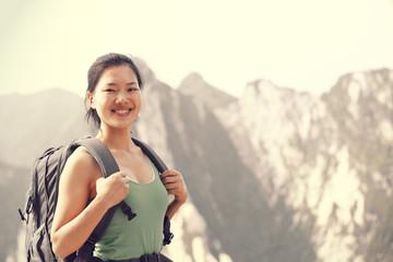 woman hiker on mountain huashan peak