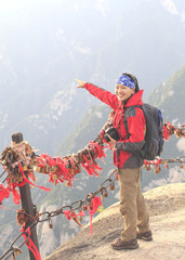 woman hiker on mountain huashan peak
