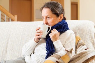 woman drinking hot tea
