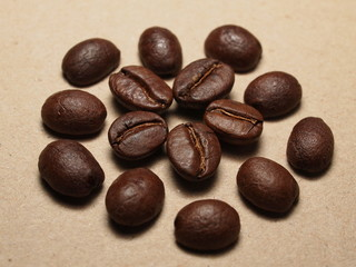 Roasted Coffee Beans on paper texture background