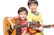 little sibling boy playing guitar and ukulele happy face - 62716799
