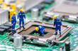 Leinwanddruck Bild - Group of construction workers repairing CPU