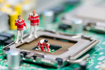 Group of paramedics recovering damaged CPU