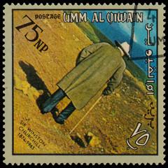 UMM AL QIWAIN - CIRCA 1966: A stamp printed in UAQ devoted Winst