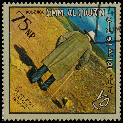 Poster UMM AL QIWAIN - CIRCA 1966: A stamp printed in UAQ devoted Winst