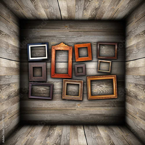 collection of beautiful frames on wood wall