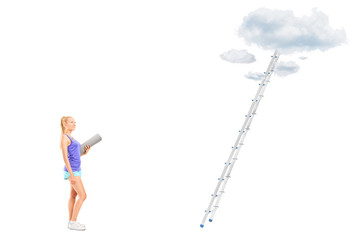 Woman with a mat standing in front of ladder