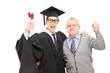 Young man and his father celebrating graduation
