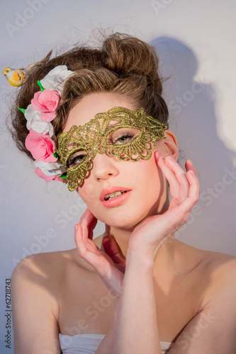 beautiful girl in a mask