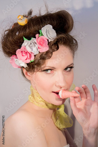 beautiful girl with ice cream and flowers in her hair
