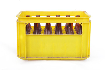 Vintage yellow beer crate with empty bottles