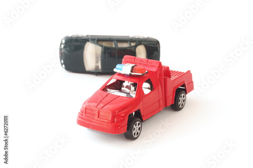 toy cars in accident on white background