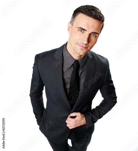 Confident businessman standing isolated on a white background