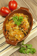 tuffed cabbage with sauce decorated with parsley