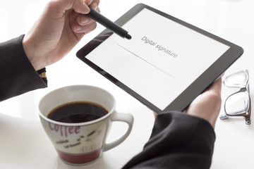 Hands with tablet signing