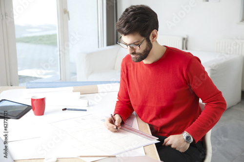Young businessman working in architect studio