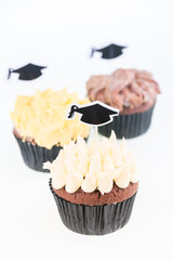 Graduation cupcakes with mortarboard cake picks