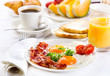 Breakfast with fried eggs, coffee,  juice, croissant and fruits - 62721929