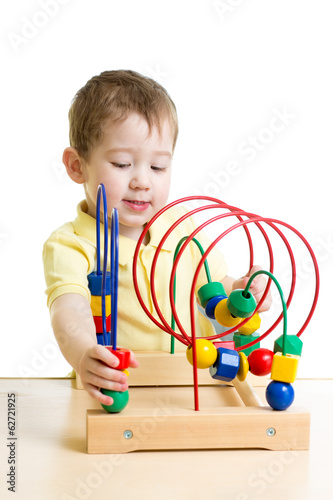 kid boy playing with color educational toy