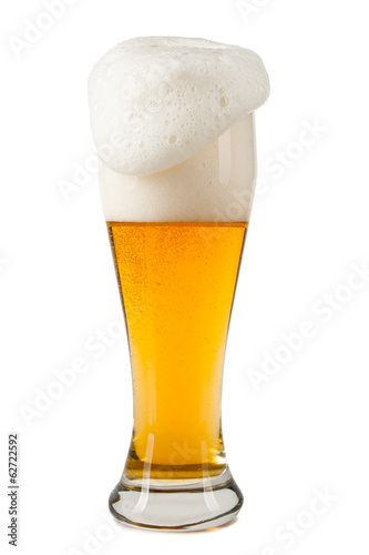Half litre glass of beer on white background