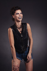 creative sexy girl in a black vest laughs