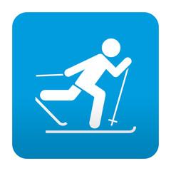 Etiqueta tipo app azul simbolo esqui de fondo