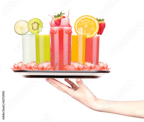 tasty summer fruit drinks on tray with woman hand