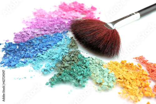 Rainbow crushed eyeshadow and professional make-up brush close