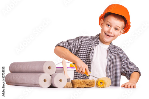 little boy with wallpaper and paint roller