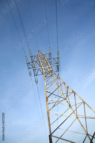 High-voltage power line metal prop  over cloudless blue sky